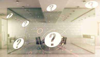 Blurred office space with question mark icons floating in air